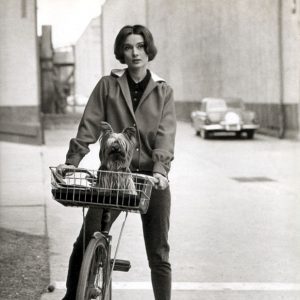 Audrey Hepburn and Mr. Famous ride a bike.