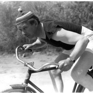 El Brendel rides a bike.