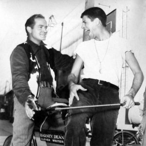 Bob Hope and Jerry Lewis ride a bike.
