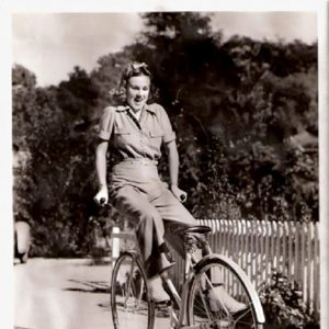 Deanna Durbin rides a bike. Backwards.