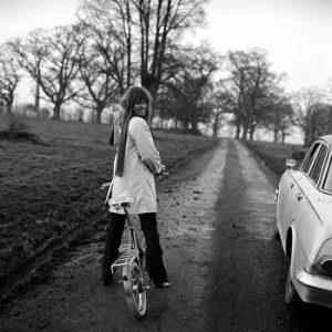 Julie Christie rides a bike.
