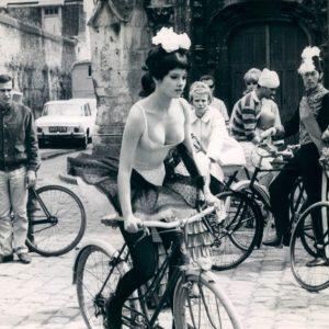 GenevièveBujold rides a bike.