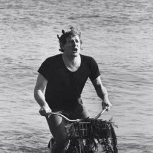Richard Harris rides a bike. In the water. Singing.