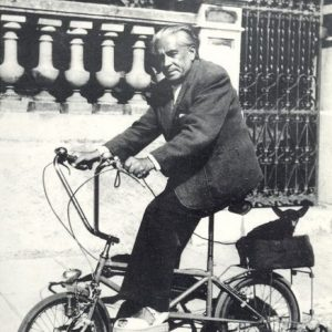 Francis Picabia and Ninie ride a bike.