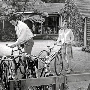 Warren Beatty and Jean Seberg take bikes for a ride.