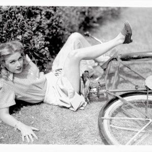 Louise Allbritton falls off a bike.