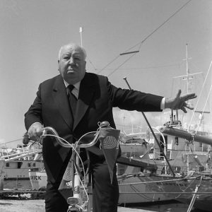 Alfred Hitchcock rides a bike. And signals.