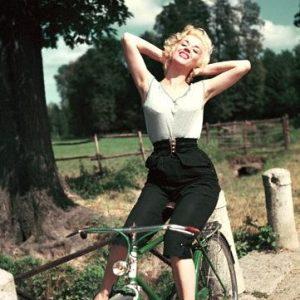 Rosalina Neri rides a bike.