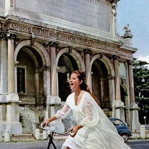 Claudia Cardinale rides a bike. Barefoot.