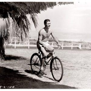 Don Ameche rides a bike. Shirtless.