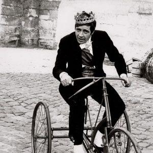 Alan Bates rides a trike.