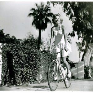 Brenda Joyce rides a bike.