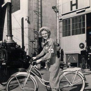 Veronica Lake rides a bike.