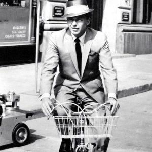 Frank Sinatra rides a bike.