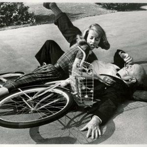 Jane Fonda rides a bike. Into Marc Connelly.