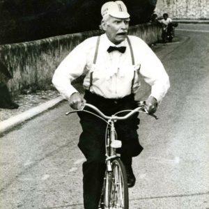 Laurence Olivier rides a bike.