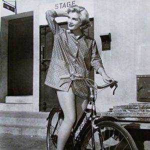 Lizabeth Scott rides a bike.