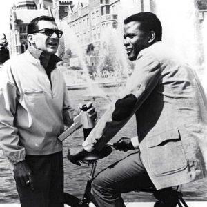 Sidney Poitier rides a bike. Sydney Pollack directs.