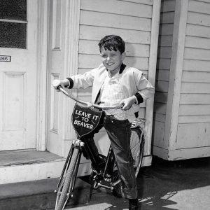 Jerry Mathers rides a bike.