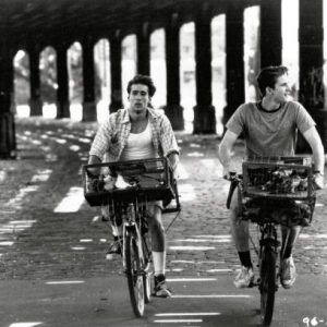 Nicolas Cage and Matthew Modine ride bikes.
