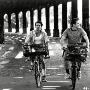 Nicolas Cage and Matthew Modine ride bikes.