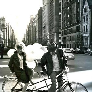 Barbara Harris and Jason Robards ride a bike.