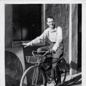 Gary Cooper rides a bike.