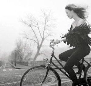 Vanessa Paradis rides a bike.