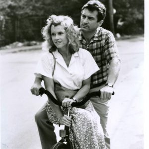 Robert De Niro and Jane Fonda ride a bike.