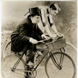 Jean Hersholt rides bikes. (See caption below.)