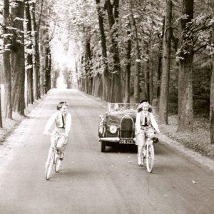 Essy Perrson and Anna Gael ride bikes.