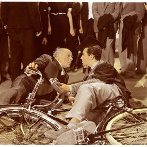 Robert Taylor and Edmund Gwenn fall off bikes.