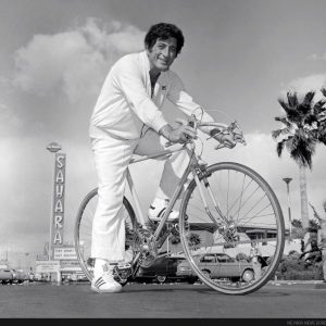 Tony Bennett rides a bike.