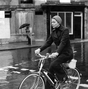 Ingrid Bergman rides a bike.