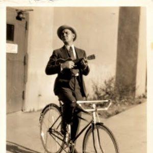 Cliff Edwards ukuleles a bike.