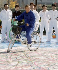 Takeshi Kitano rides a bike. And paints.