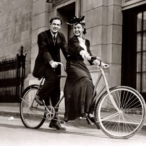 William Holden and Bonita Granville ride a bike.