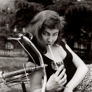 Adrienne Corri curls up with a bike.