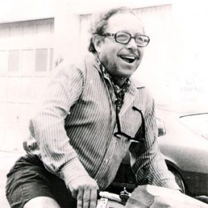 Tennessee Williams rides a bike.