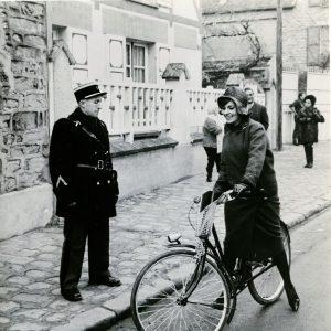 Jeanne Moreau rides a bike.