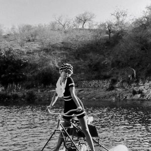 Brigitte Bardot rides an aqua bike.