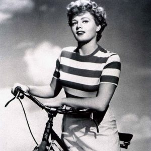 Shelley Winters rides a bike. Stripedly.