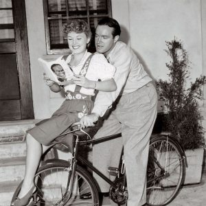 Bob Hope and Phyllis Ruth ride a bike. And read a book.