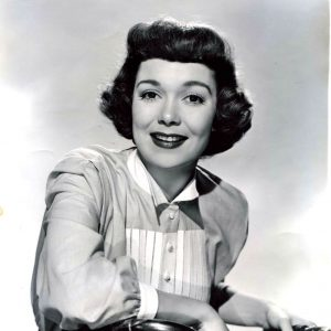 Jane Wyman rides a bike. Or rests coolly on bars and stem, at least.