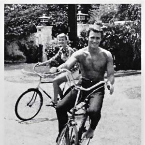 Clint Eastwood rides a bike.