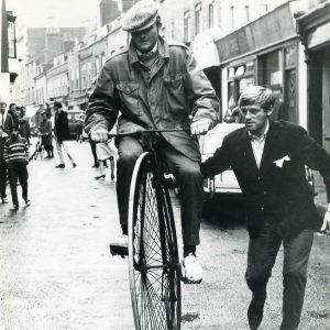 Michael Parks rides a bike. John Leyton lends a hand.