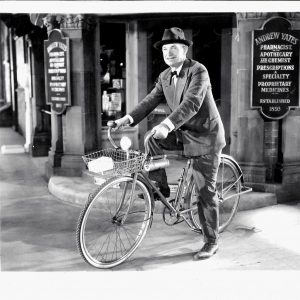Will Rogers rides a bike.
