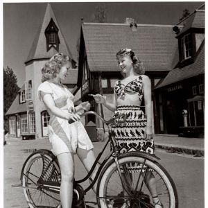 Virginia Mayo rides a bike. Vera-Ellen offers chocolate.