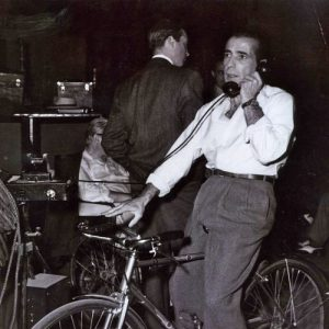 Humphrey Bogart rides a bike. And takes a call.
