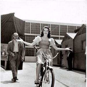 Dorothy Malone rides a bike. Hands-free.